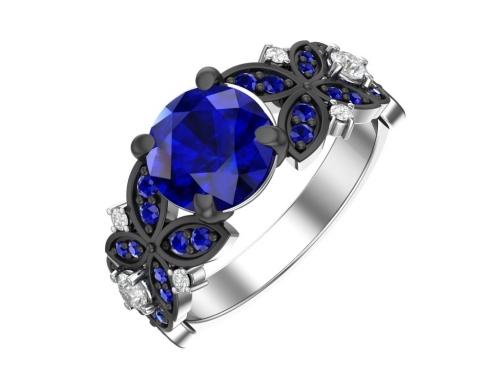 Серебряное кольцо с кварцем синтетическим сапфировым и фианитами